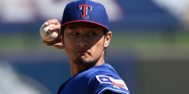 SURPRISE, AZ - MARCH 05: Yu Darvish #11 of the Texas Rangers pitches in the first inning against the...