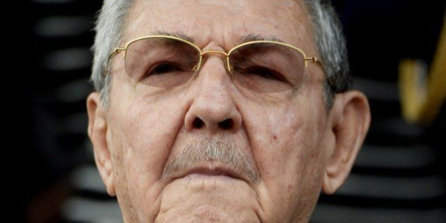 Cuban President Raul Castro listens to national anthems during the ALBA Summit at the Miraflores Palace,...