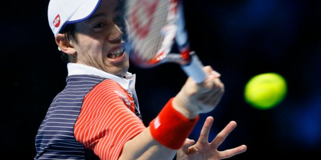 Japan's Kei Nishikori plays a return to Spain's David Ferrer during their ATP World Tour tennis finals...