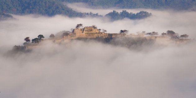 Japan, Kinki Region, Hyogo Prefecture, Asago - Hyogo, Takeda castle in foggy morning. (Photo by: JTB/UIG...