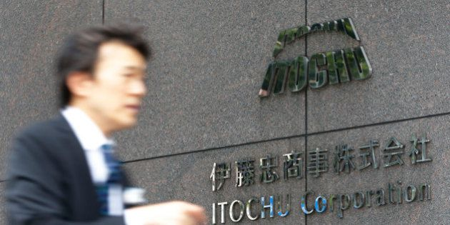 A pedestrian walks past the Itochu Corp. headquarters in Tokyo, Japan, on Tuesday, Sept. 18, 2012. Itochu...
