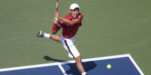 NEW YORK, NY - SEPTEMBER 6 : Kei Nishikori of Japan returns the ball to Novak Djokovic of Serbia during...