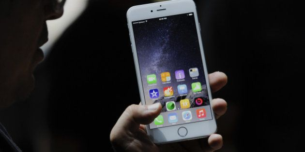 An attendee demonstrates the new Apple Inc. iPhone 6 Plus after a product announcement at Flint Center...