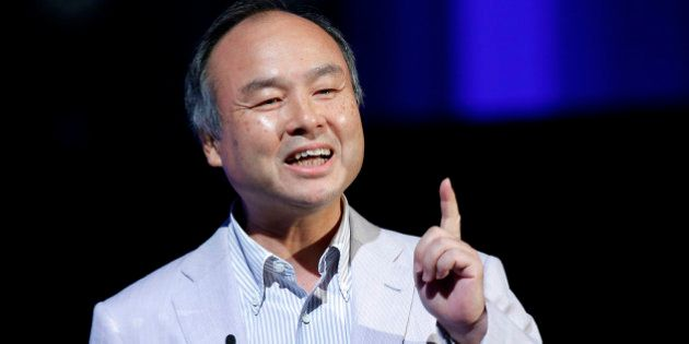 Masayoshi Son, chairman and chief executive officer of SoftBank Corp., gestures as he speaks at SoftBank...