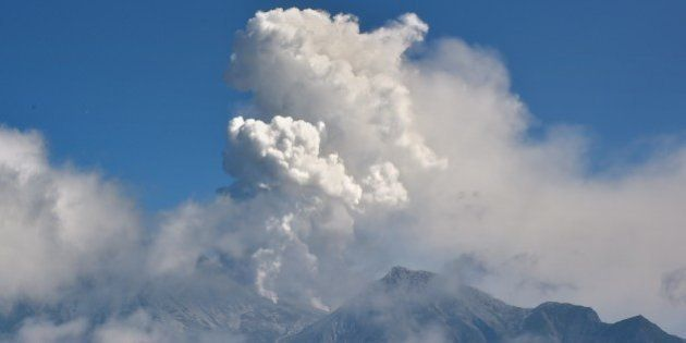 A cloud of volcanis ash rise from Mount Ontake seen from Gifu prefecture on September 28, 2014. More...