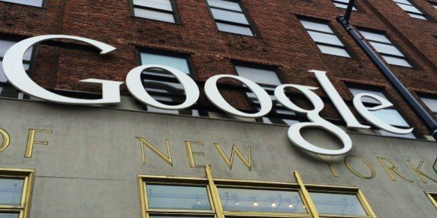 A Google sign hangs on their headquarters May 21, 2014 in New York