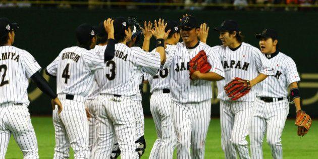 TOKYO, JAPAN - NOVEMBER 15: Samurai Japan celebrate after winning the game three of Samurai Japan and...