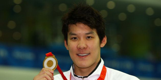 BEIJING - AUGUST 10: Park Taehwan of South Korea poses with the gold medal during the medal ceremony...