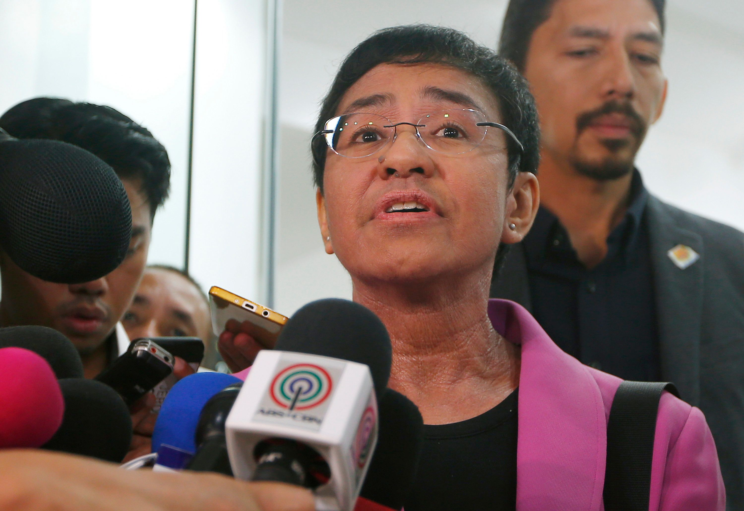 Maria Ressa, CEO of the online news agency Rappler, talks to the media after attending the summons by the National Bureau of Investigation on the cyber libel complaint filed against Rappler five years ago Monday, Jan. 22, 2018 in Manila, Philippines. Last week, the Philippine securities commission revoked the registration of Rappler, known for its critical reporting on Philippine President Rodrigo Duterte, a move media watchdogs said is an act to muzzle the free press. (AP Photo/Bullit Marquez)
