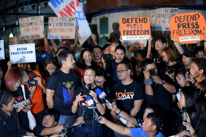 This file photo taken on January 19, 2018 shows Maria Ressa (C-with microphone), the CEO and editor of online portal Rappler,