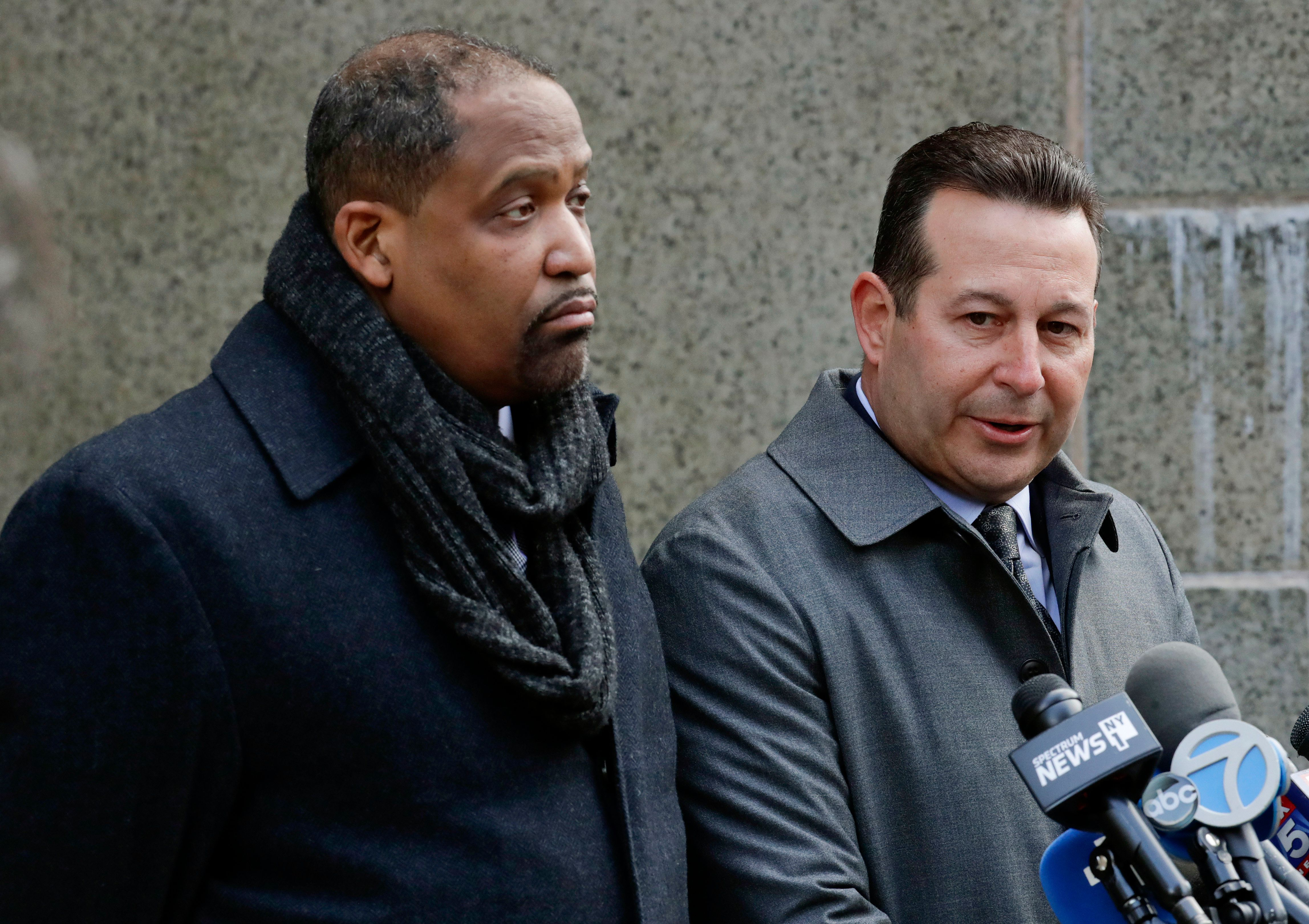 Two of Harvey Weinstein's attorneys, Ronald Sullivan (left) and Jose Baez, speak outside a Manhattan courthouse in January. S