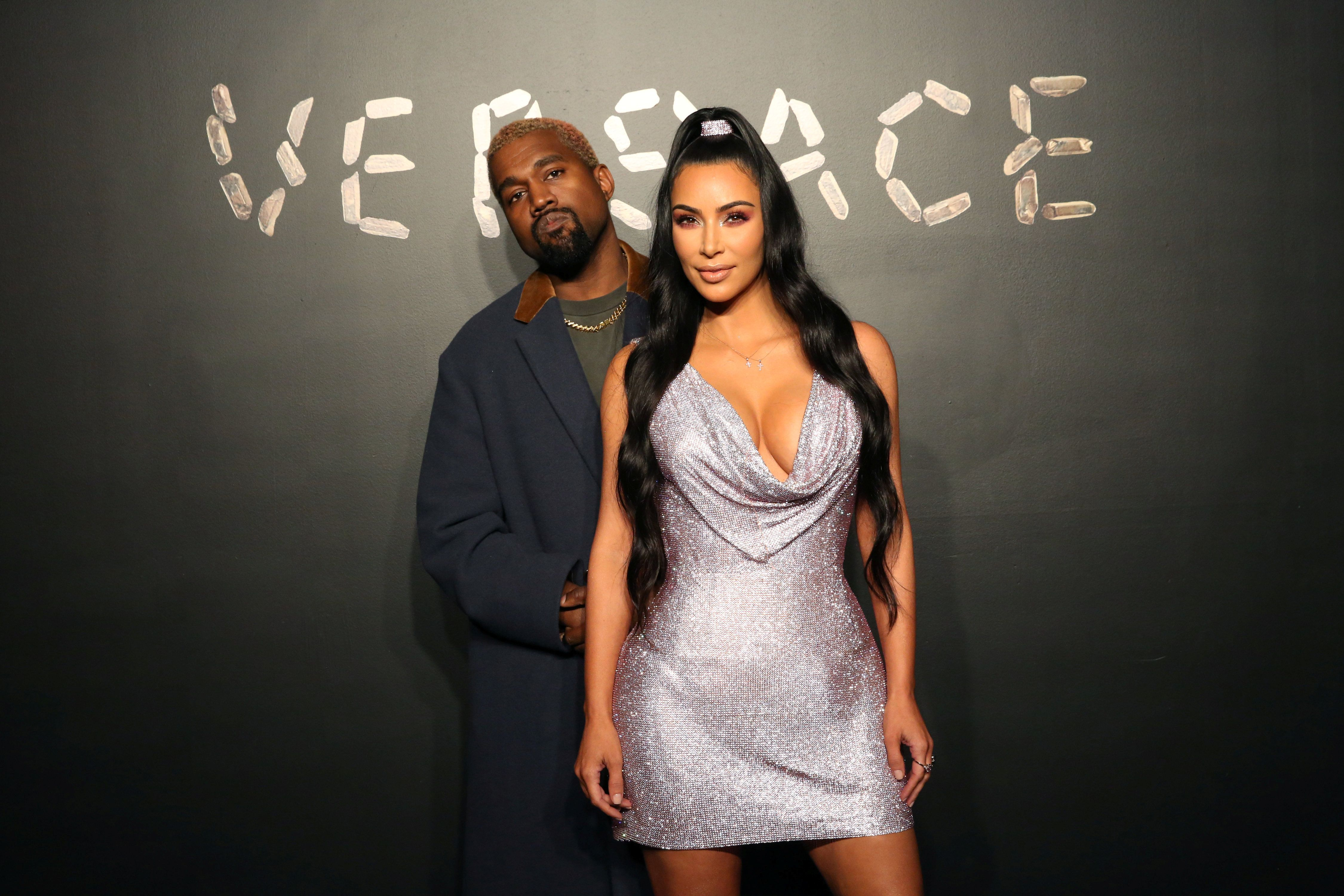 Kanye West and Kim Kardashian pose for a photo before attending the Versace presentation in New York, U.S. December 2, 2018. REUTERS/Allison Joyce