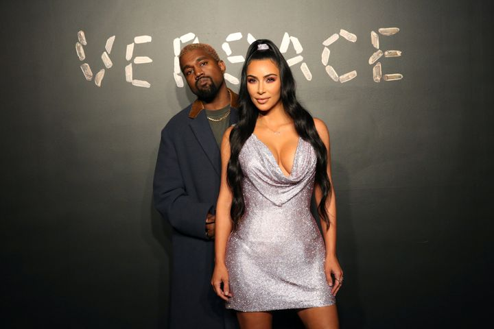 Kanye West and Kim Kardashian pose for a photo before attending the Versace presentation in New York, U.S. Dec. 2, 2018.&nbsp