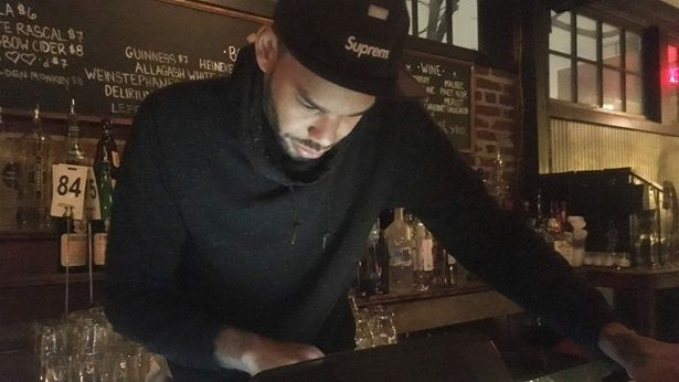 Tim Slayton, 36, rings up a drink at Marvin, a 14th Street bar in Washington, D.C. Millennials and Gen Z make up about 35 per