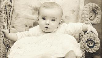 Vintage photo of a cute baby girl.