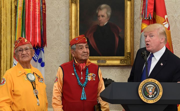 Here's Trump standing with Native American veterans in front of a portrait of Andrew Jackson in the Oval Office. He attacked