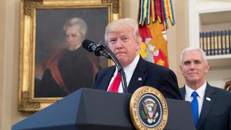 A portrait of former President Andrew Jackson hangs on the wall behind President Donald Trump, accompanied by Vice President Mike Pence, as he takes the podium to speak for a signing ceremony for executive orders regarding trade in the Oval Office at the White House, Friday, March 31, 2017, in Washington. Trump spoke to the media but left before signing the orders. (AP Photo/Andrew Harnik)
