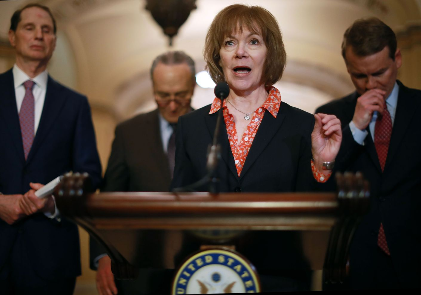 Democrats, led by Sen. Tina Smith (center), are pushing a bill to allow federal agencies to reimburse contractors that p
