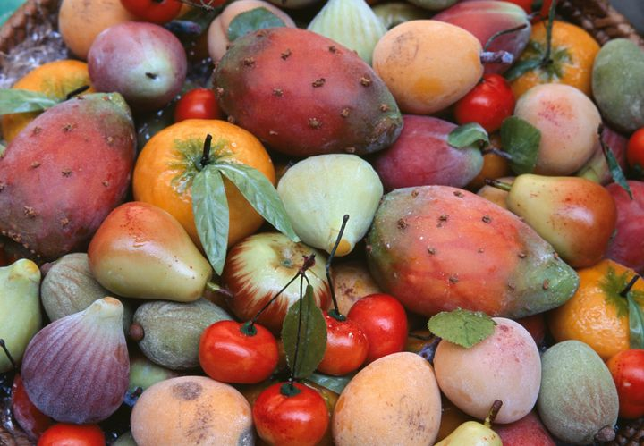 "In Sicily, people make beautiful <i>frutta di martorana</i> (marzipan fruits) for All Souls' Day."" width=""720″ height=""498″></div> <p><span aria-hidden="
