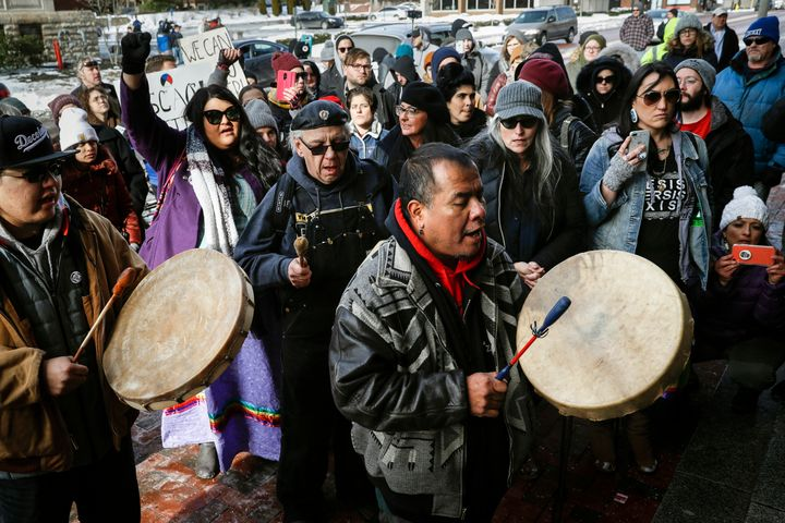 A protester leads a Native American prayer with a traditional drum outside the Catholic Diocese of Covington, Kentucky, on Ja