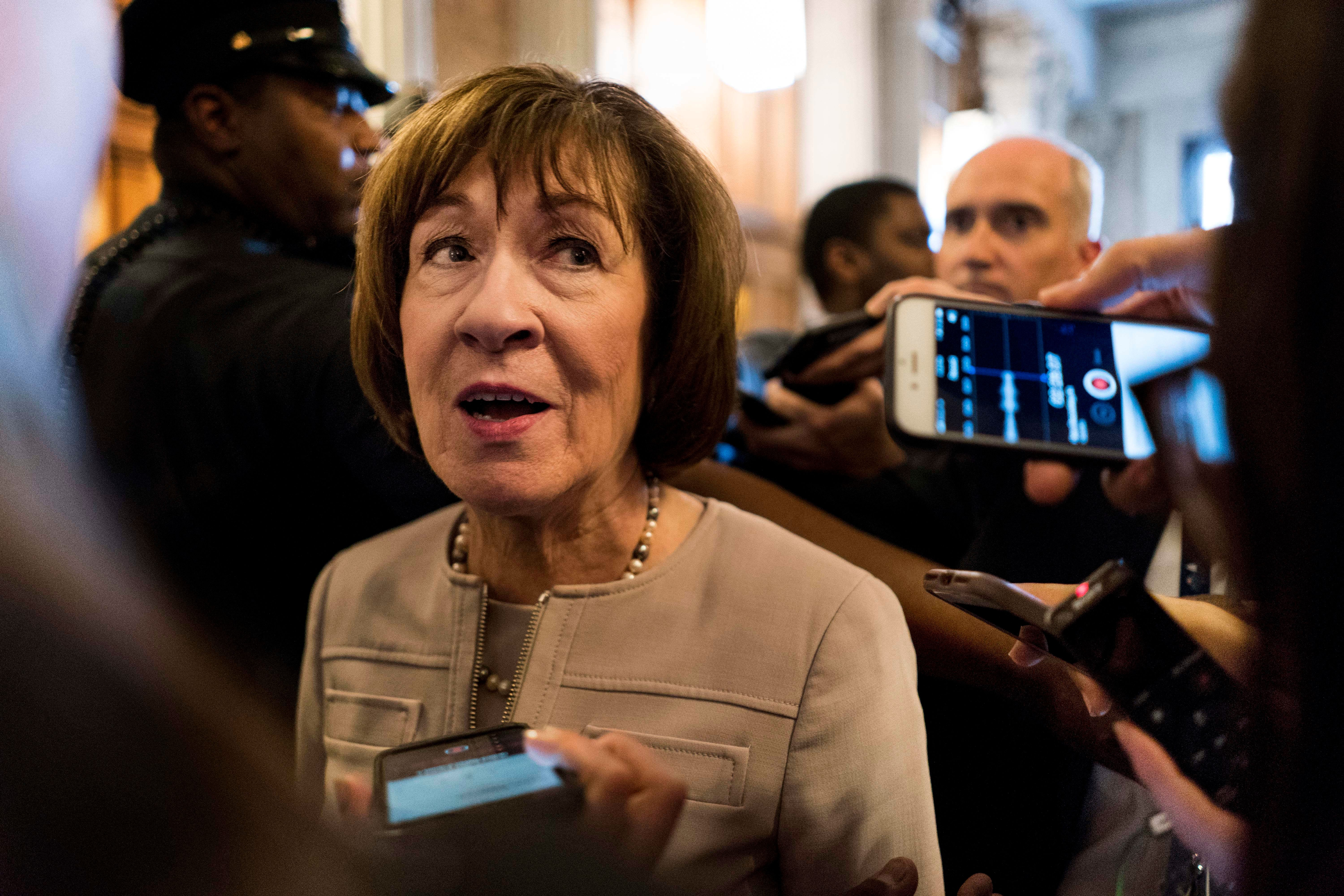WASHINGTON, DC - Senator Susan Collins (R-ME) talks to a crowd a journalists after speaking on the Senate floor in favor of US Supreme Court nominee Judge Brett Kavanaugh   on Capitol Hill in Washington DC Friday October 5, 2018. (Photo by Melina Mara/The Washington Post via Getty Images)