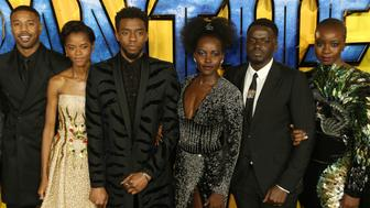"""FILE - In this Feb. 8, 2018 file photo, actors Michael B. Jordan, Leitia Wright, Chadwick Boseman, Lupita Nyong'o, Daniel Kaluuya and Danai Gurira pose for photographers upon arrival at the premiere of the film """"Black Panther"""" in London. Stan Lee, the master and creator behind Marvel's biggest superheroes, died at age 95 Monday, Nov. 12, 2018, at a Los Angeles hospital. As fans celebrate Lee's contributions to the pop culture canon, some have also revisited how Lee felt that with his great comic books came great responsibility. (Photo by Joel C Ryan/Invision/AP, File)"""