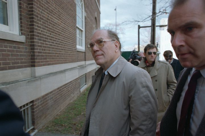 Lyndon LaRouche enters the United States District Court to face charges of mail fraud and tax evasion in 1988.