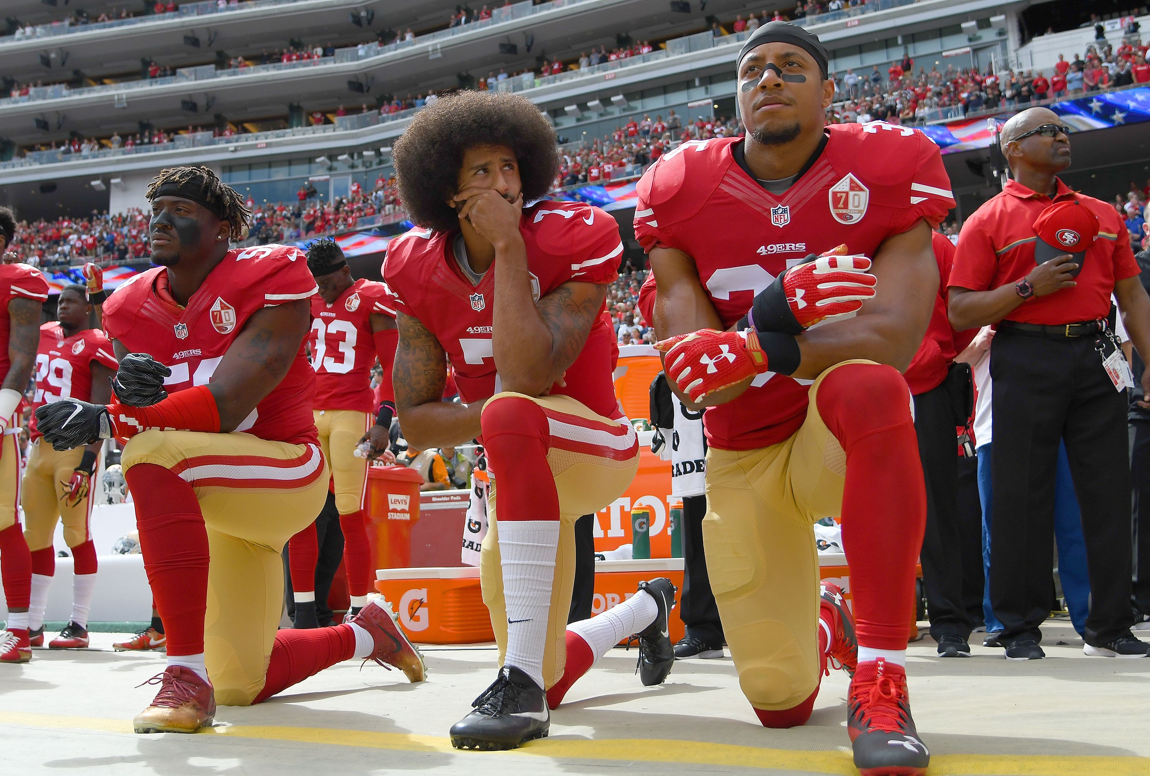 SANTA CLARA, CA - OCTOBER 02:  (L-R) Eli Harold #58, Colin Kaepernick #7 and Eric Reid #35 of the San Francisco 49ers kneel on the sideline during the National Anthem prior to the game against the Dallas Cowboys at Levi's Stadium on October 2, 2016 in Santa Clara, California.  (Photo by Thearon W. Henderson/Getty Images)