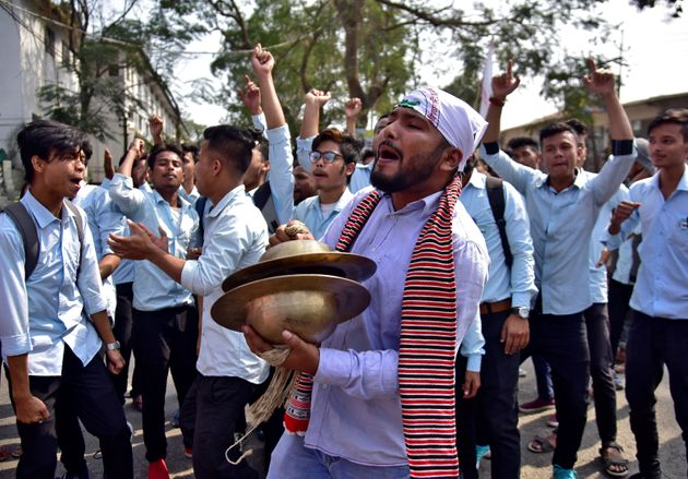 Students shout slogans during a protest to demand the withdrawal of the Citizenship Amendment Bill in...