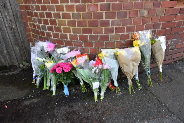 Floral tributes left outside Cowick Lane, Exeter, where the bodies of twins Dick and Roger Carter, aged...
