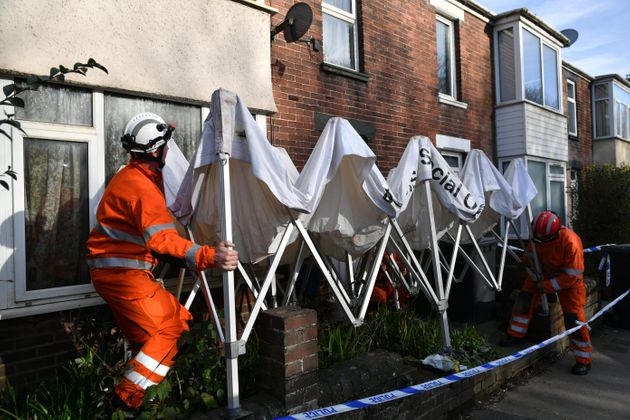 Members of fire and rescue erect a gazebo outside the address in Bonhay