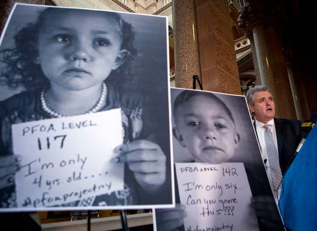 New York state Assemblyman Steve McLaughlin, a Republican, shows photos of children from Hoosick Falls,...