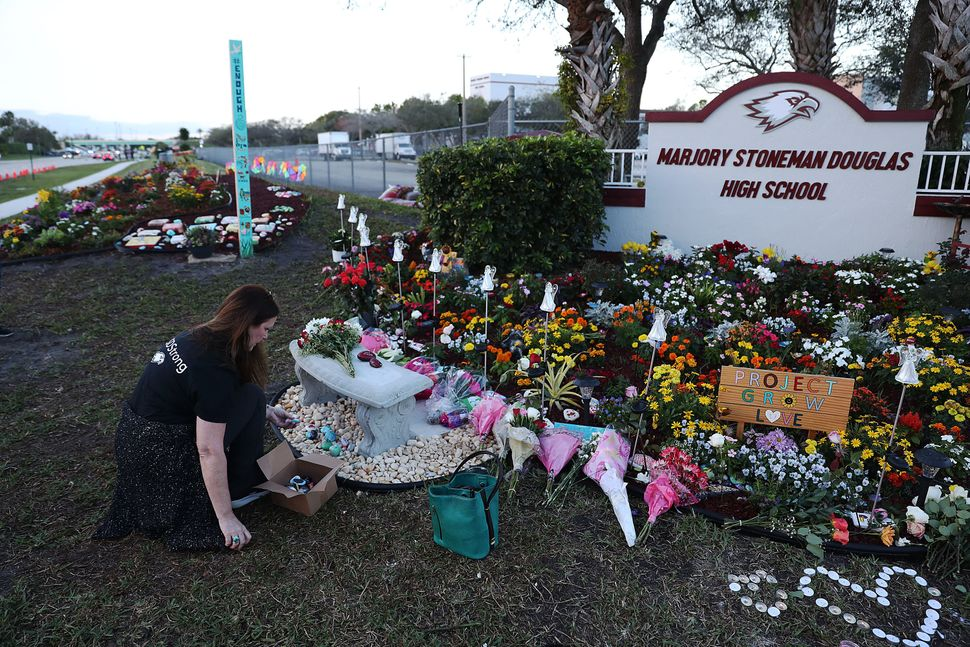 Suzanne Devine Clark visits a memorial at Marjory Stoneman Douglas High School for those killed during a mass shooting on Feb