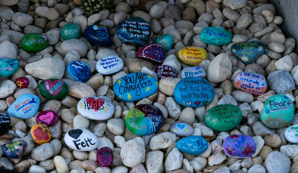 Stones are placed at a memorial outside Marjory Stoneman Douglas High School.