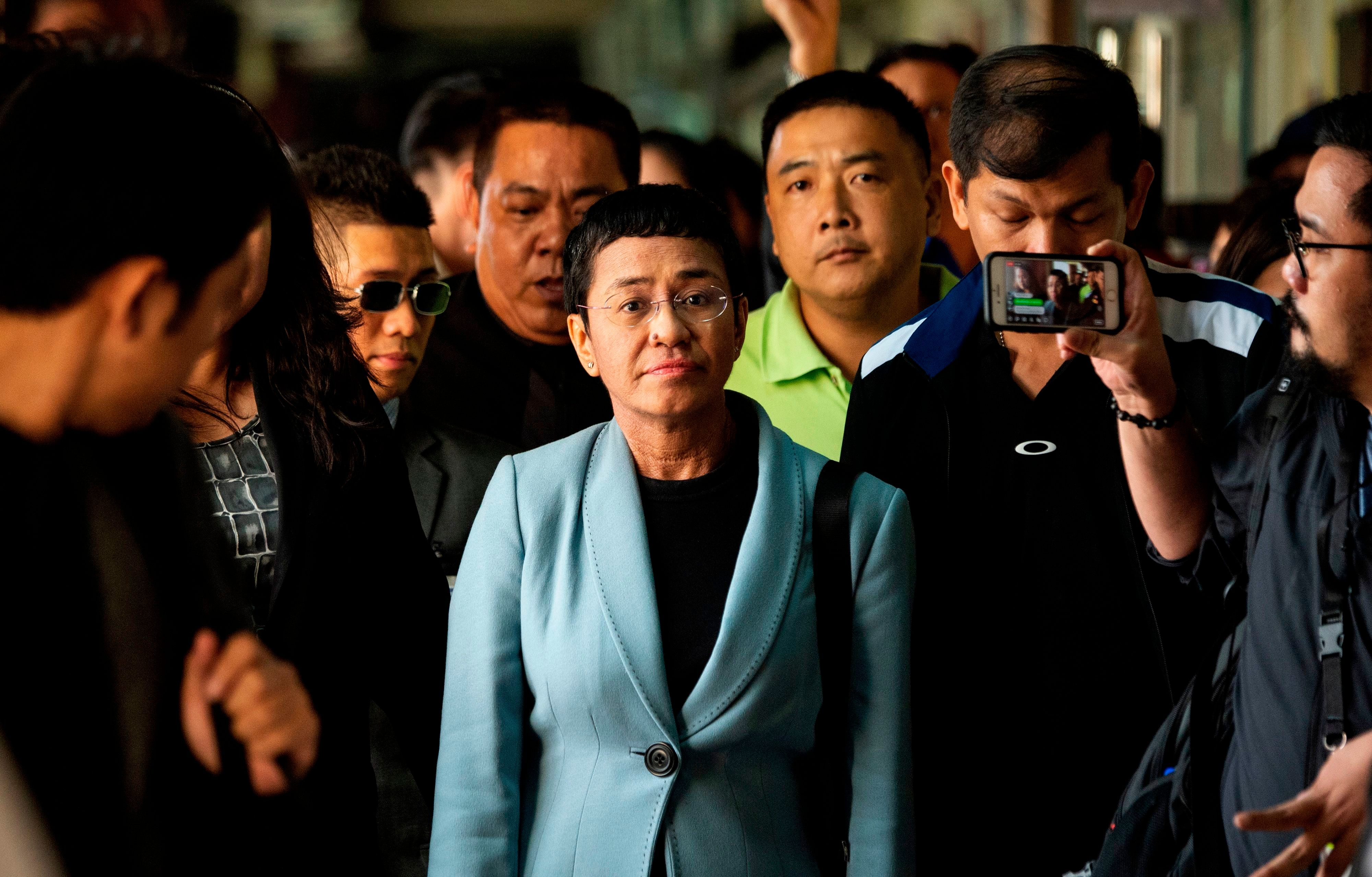 Philippine journalist Maria Ressa (C) arrives at a regional trial court in Manila to post bail on February 14, 2019. - Ressa was freed on bail on February 14 following an arrest that sparked international censure and allegations she is being targeted over her news site's criticism of President Rodrigo Duterte. (Photo by Noel CELIS / AFP)        (Photo credit should read NOEL CELIS/AFP/Getty Images)
