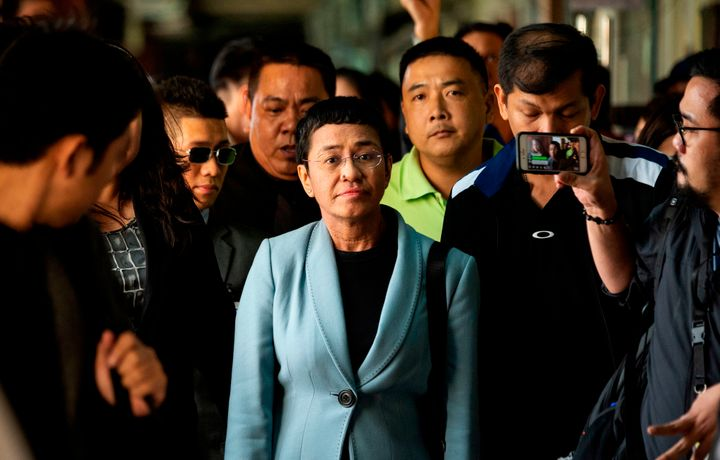 A day after being arrested on libel charges, Maria Ressa arrives at a court in Manila to post bail, Feb. 14. Her website, Rap