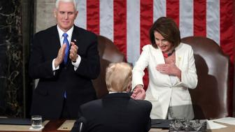 President Donald Trump shakes hands with House speaker Nancy Pelosi after he delivered his State of the Union address to a joint session of Congress on Capitol Hill in Washington, as Vice President Mike Pence watches, Tuesday, Feb. 5, 2019. (AP Photo/Andrew Harnik)
