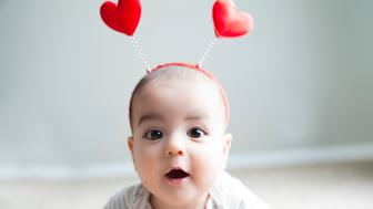 7 month old baby models hearts on his head