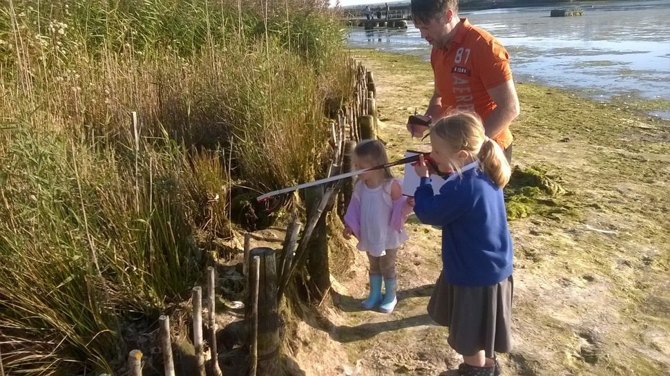 Paul and his daughters doing some litter picking in a drained lake in the