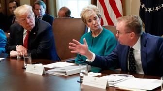 President Donald Trump, left, and Small Business Administration administrator Linda McMahon, center, listen as Director of the Office of Management and Budget Mick Mulvaney speaks during a cabinet meeting in the Cabinet Room of the White House, Wednesday, Oct. 17, 2018, in Washington. (AP Photo/Evan Vucci)