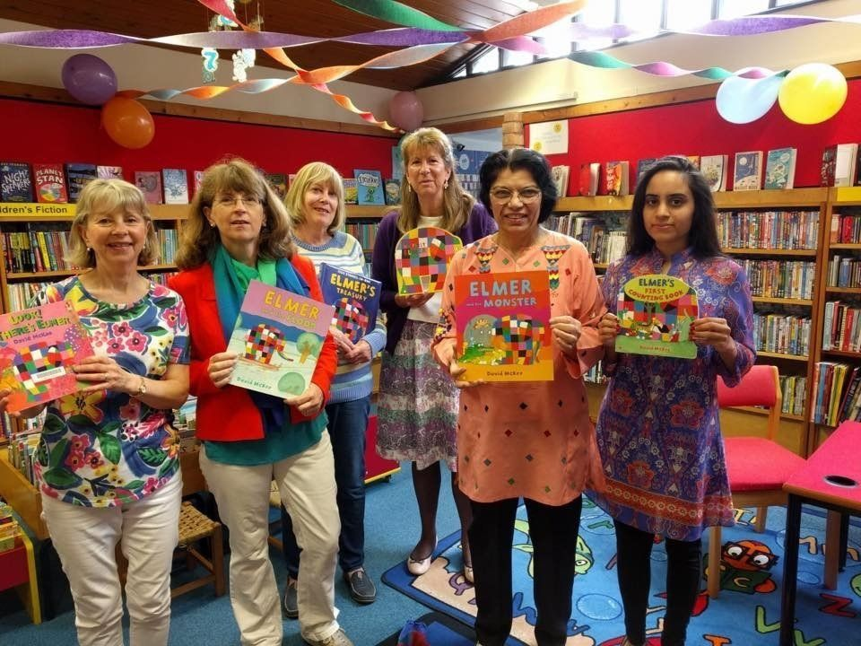A group of volunteers all looking colourful on Elmer Day – a special event organised for children...