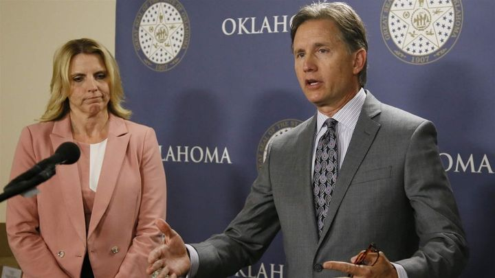 Republican Oklahoma Attorney General Mike Hunter, right, gestures as he speaks at a 2017 news conference about forming an opi