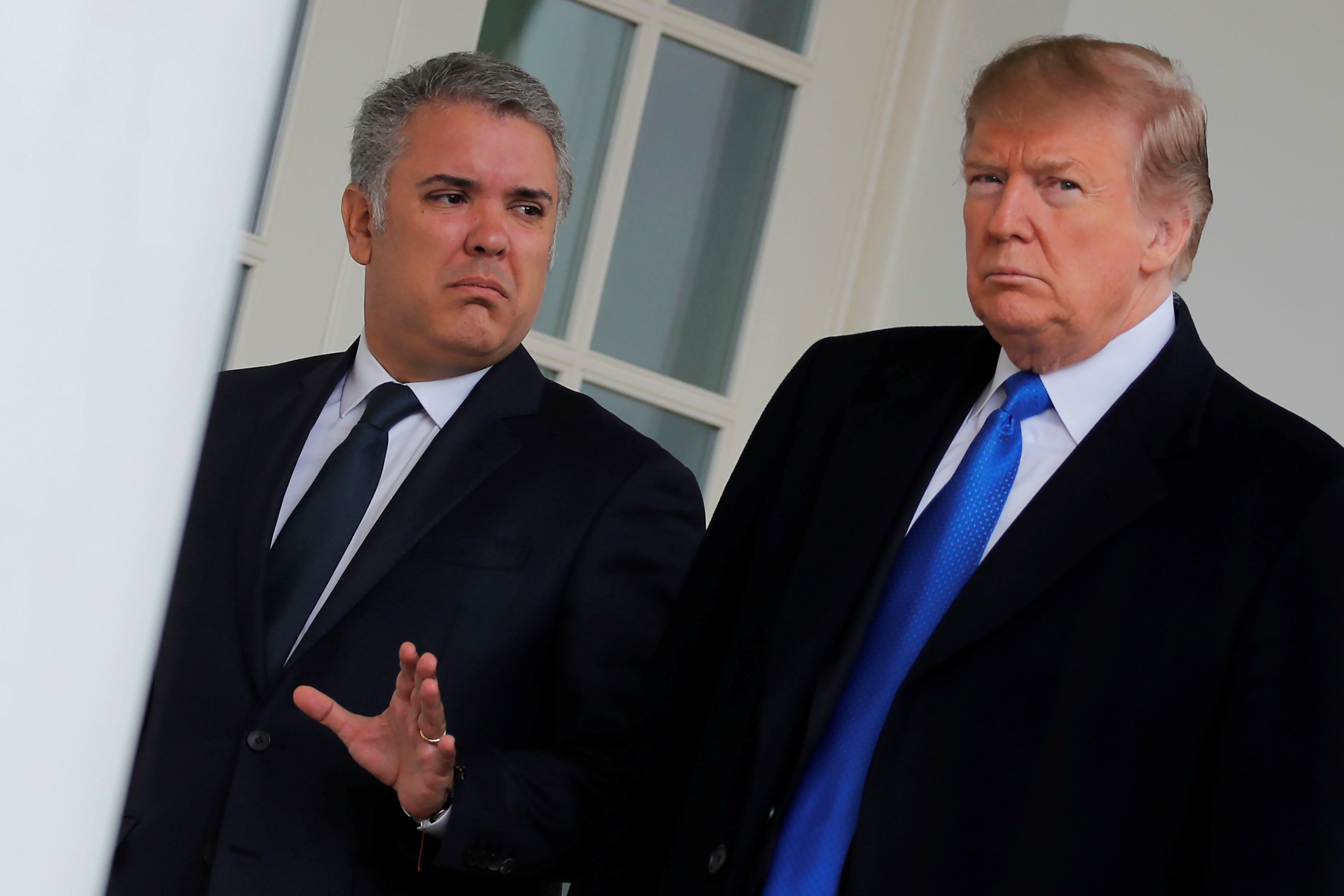 U.S. President Donald Trump walks with Colombian President Ivan Duque at the White House in Washington, U.S., February 13, 2019. REUTERS/Carlos Barria