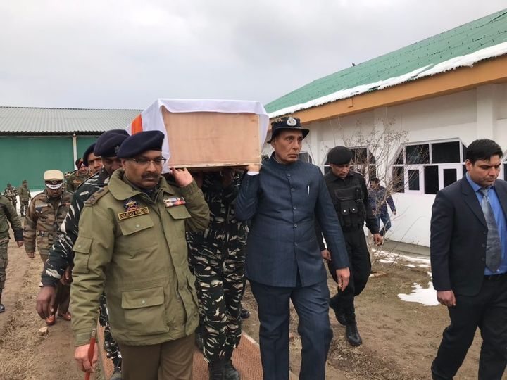 Rajnath Singh carries coffin of soldier killed in Pulwama attack.