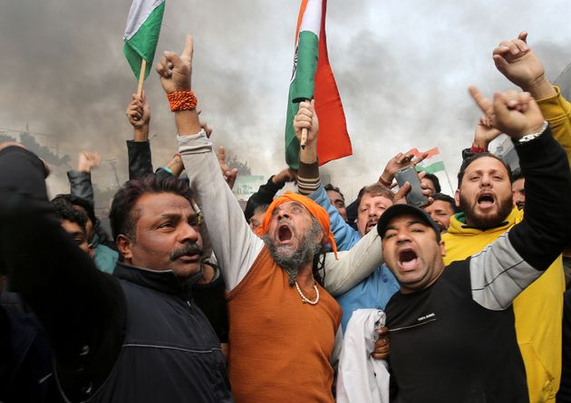 People shout slogans during a protest against the attack on a bus carrying CRPF personnel in
