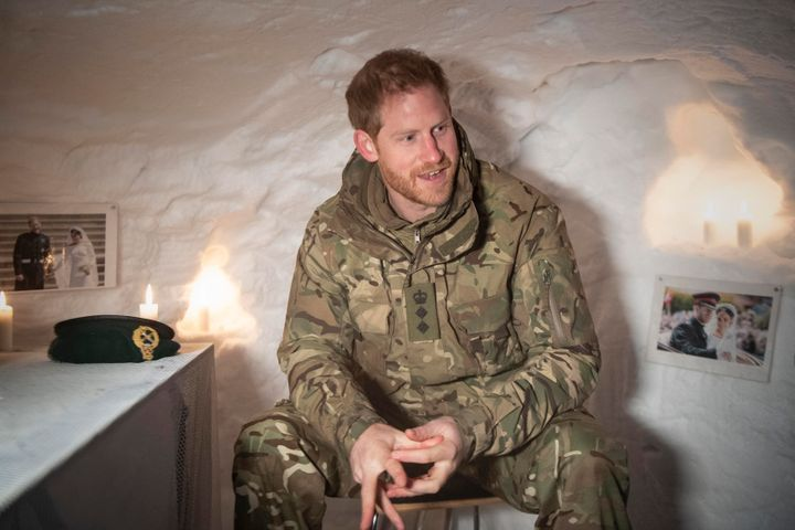 Prince Harry, Duke of Sussex, sits in a Quincey Shelter, a makeshift shelter built of snow, which doubled as a personal shrin