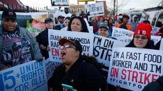 Nancy Salgado, center, leads chants outside a McDonald's in Chicago during a nationwide day of protests organized by the SEIU-backed Fight for $15 movement on Wednesday, April 15, 2015. (Michael Tercha/Chicago Tribune/TNS via Getty Images)