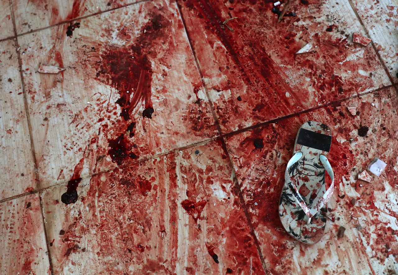Blood stains the floor of a home near Rio's Santa Teresa neighborhood. Local residents say police killed at least 13 people in a Feb. 9, 2019, operation, including some who were shot execution-style inside the home.