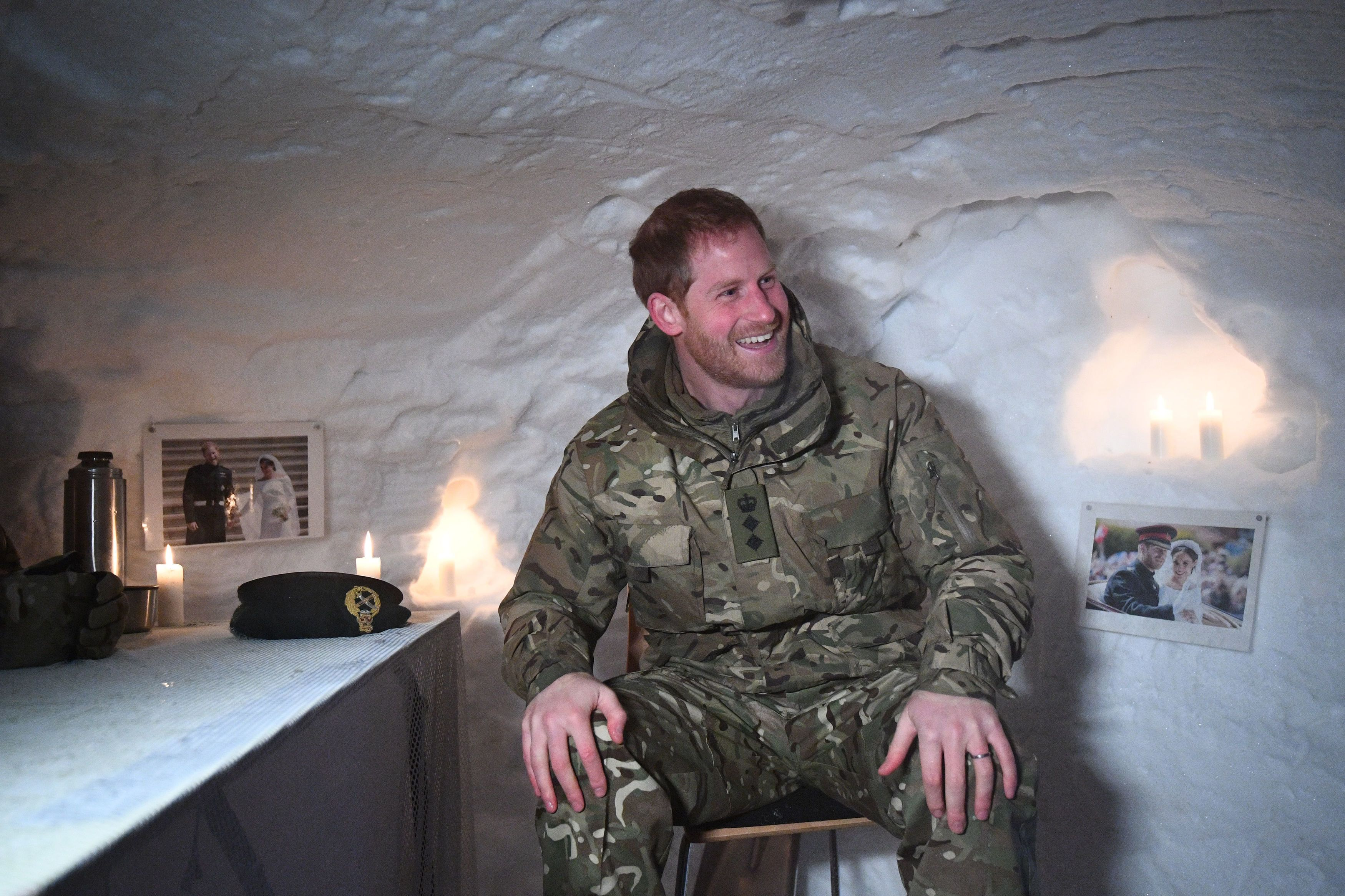 BARDUFOSS, NORWAY - FEBRUARY 14: Prince Harry, Duke of Sussex in a Quincey Shelter, a makeshift shelter built of snow, during a visit to Exercise Clockwork in Bardufoss, Norway, for a celebration of the 50th anniversary of the Commando Helicopter Force and Joint Helicopter Command deploying for extreme cold weather training, on February 14, 2019 in Bardufoss, Norway. Exercise Clockwork is the traditional name for the annual winter exercise, based in one of the world's most demanding environments, 200 miles inside the Arctic Circle in north Norway. (Photo by Victoria Jones - Pool/Getty Images)