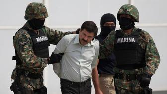 "FILE - In this Saturday, Feb. 22, 2014 file photo, Joaquin ""El Chapo"" Guzman, center, is escorted to a helicopter in handcuffs by Mexican navy marines at a hanger in Mexico City, after he was captured overnight in the beach resort town of Mazatlan. The New York trial of Guzman is drawing to a close, but the question of controlling the corruption that allowed the Sinaloa cartel to flourish in Mexico will live on even after jurors reach a verdict. DEA agent Victor Vazquez told jurors he would only work with the Mexican marines when trying to capture Guzman and other leaders of the Sinaloa cartel, because that wing of the armed forced were viewed as less susceptible to corruption. (AP Photo/Eduardo Verdugo, File)"